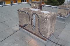 Převěs kabelu mezi bytovkami